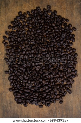 Fresh coffee beans on wood and linen bag, ready to brew delicious coffee #699439357