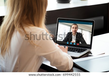 Businesswoman making video call to business partner using laptop, looking at screen with virtual web chat, contacting client by conference, talking on webcam, online consultation, hr concept, close up #699442555