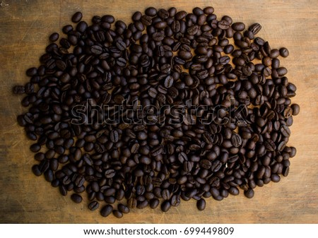 Fresh coffee beans on wood and linen bag, ready to brew delicious coffee #699449809
