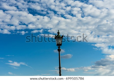 old vintage light pole and sky with clouds #699505786