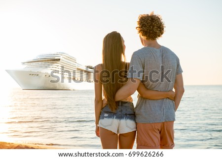Happy smiling couple who travel by cruiseship. Concept of holiday and summertime