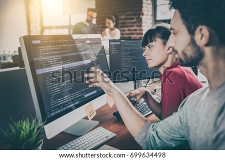 Developing programming and coding technologies. Website design. Programmer working in a software develop company office. Royalty-Free Stock Photo #699634498