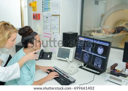 magnetic resonance and a nurse showing results #699661402