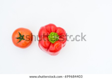 Pepper and tomato on white background #699684403