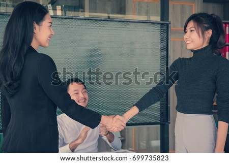Business people handshake at meeting or negotiation in the office, Business partnership meeting concept. #699735823