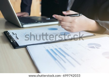 Teamwork of business two colleagues analysis with financial data and marketing report graph, Young co worker discussing and brainstorm new idea for start up project plan, Partner meetings and briefing #699742033