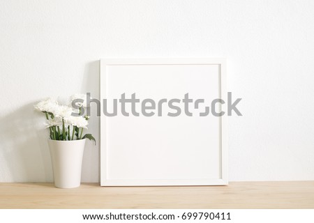 white square frame photo with flower in vase on table.home decoration