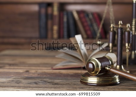 Law theme, mallet of the judge, wooden desk, books. Place for text. #699815509
