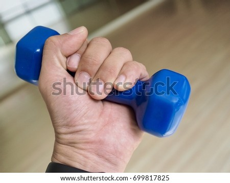"""Workout"" Close up dumbbell in hand #699817825"