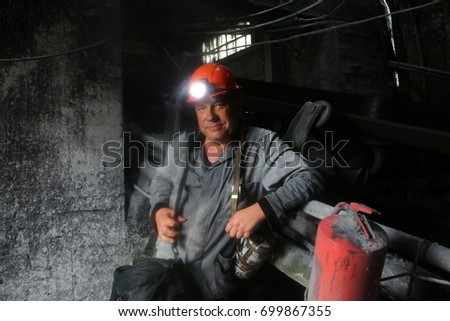 miner in a mine.  #699867355