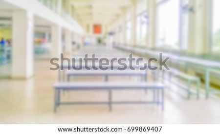 Blurred abstract background of Canteen or food court environment with white chairs and tables, open space for background usage. #699869407