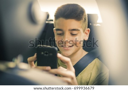child with mobile phone in the car #699936679