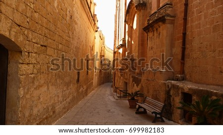A small street between the high walls.  #699982183