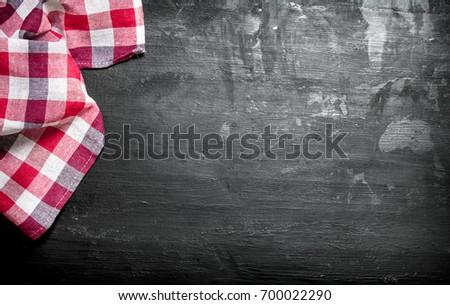 Serving background. Napkin. On a black chalkboard. #700022290