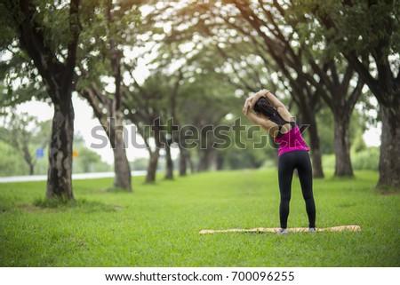 Women exercising.Women exercising in sunny bright light. #700096255