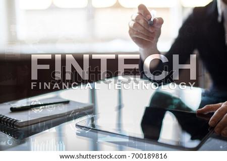 Fintech. Financial technology text on virtual screen. Business, internet and technology concept. #700189816