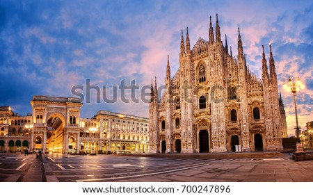 Milan Cathedral, Duomo di Milano, Italy, one of the largest churches in the world on sunrise Royalty-Free Stock Photo #700247896
