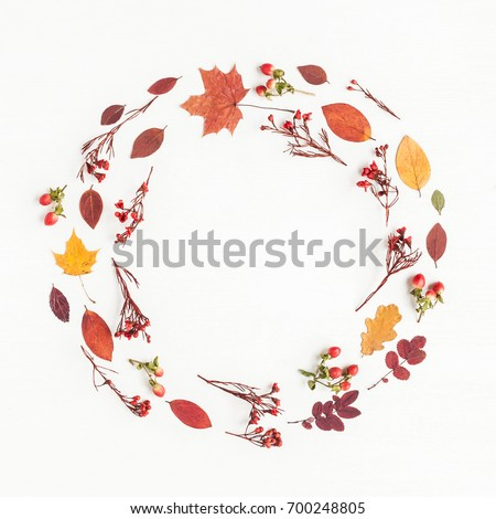 Autumn composition. Wreath made of autumn flowers and leaves on white background. Flat lay, top view, copy space. #700248805