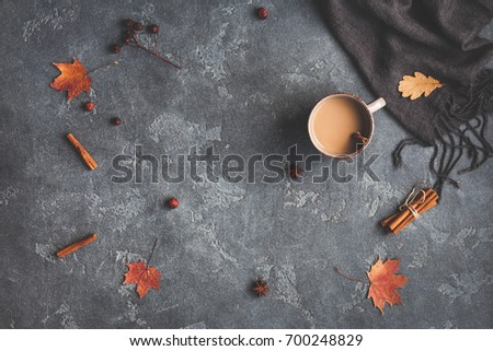 Autumn composition. Cup of coffee, blanket, autumn leaves, cinnamon sticks on black background. Flat lay, top view. #700248829