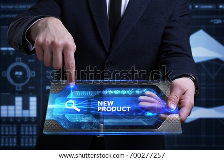 Business, Technology, Internet and network concept. Young businessman working on a virtual screen of the future and sees the inscription: New product #700277257