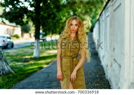 Gorgeous young blonde walking on city street. Lifestyle, outdoor #700336918