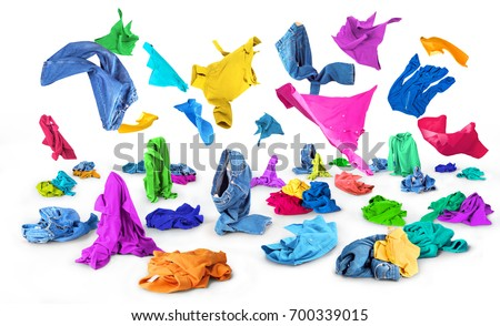 Bright clothes fall to the floor on a white background #700339015