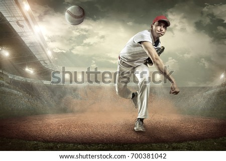 Baseball players in action on the stadium. #700381042