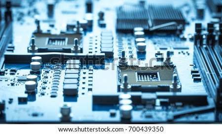 computer circuit board background. blue chip cpu core texture technology with processors microelectronics hardware concept electronic device motherboard #700439350