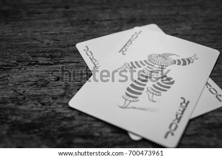 Joker card on wooden floor,Black and white pictures