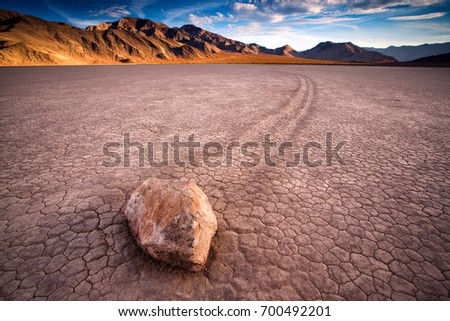 "sunset view of The Racetrack Playa, or The Racetrack, is a scenic dry lake feature with ""sailing stones"" that inscribe linear ""racetrack"" imprints. #700492201"