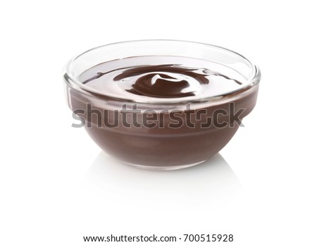Bowl with delicious chocolate sauce on white background #700515928
