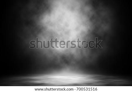 White spotlight on stage smoke entertainment background.