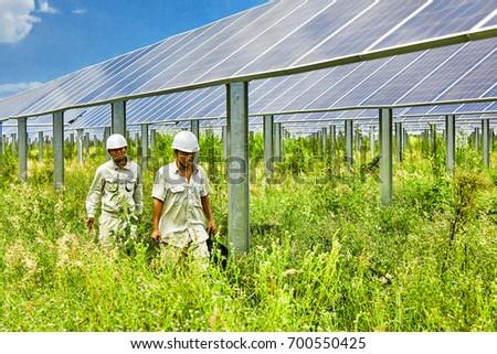 Engineers patrol solar photovoltaic #700550425