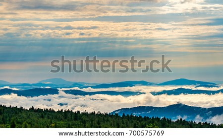 Spectacular dawn and mist over mountain range #700575769