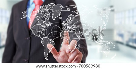Businessman on blurred background touching world connection sketch #700589980