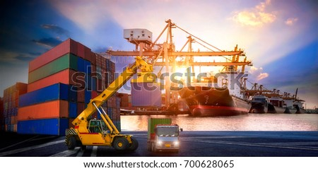 Logistics and transportation of Container Cargo ship and Cargo plane with working crane bridge in shipyard at sunrise, logistic import export and transport industry background #700628065