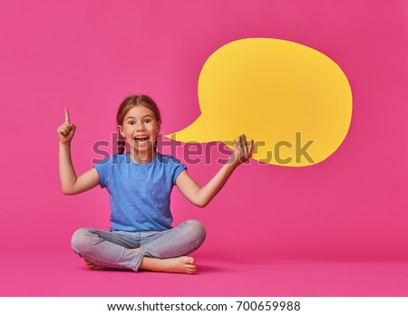 Cute little child girl with cartoon speech on colorful background. Yellow, pink and blue colors.
