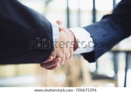 Business partnership meeting concept. Image business handshake, Successful businessmen handshaking after good deal, good team work #700675396