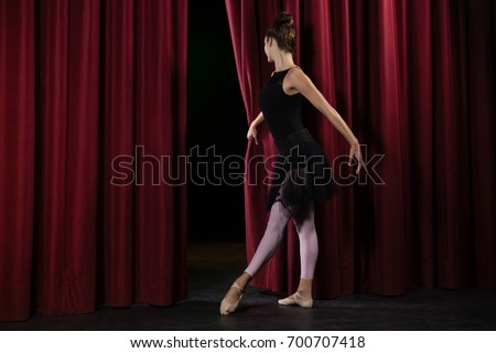 Ballerina performing ballet dance on stage in theatre #700707418