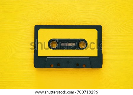 Retro cassette tape over yellow wooden table. top view. copy space #700718296