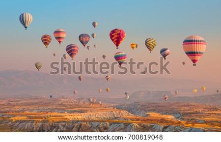 Hot air balloon flying over spectacular Cappadocia #700819048