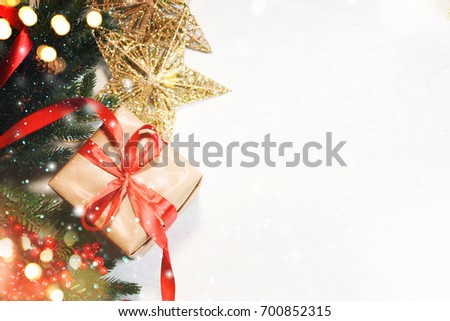 Christmas Gift Box On Wooden Background With Snowflakes, Greeting card Merry Christmas and Happy New Year #700852315
