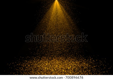 Golden sunray with sparkles or gold particle glitter light. Merry Christmas festive background.defocused circle particle bokeh. Abstract gold background #700896676