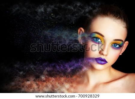 Creative photo effect portrait. Model with creative make-up. Professional retouching. European professional model. Bright make up with pigment eye shadows. Halloween. Black background. Blue eyes. #700928329