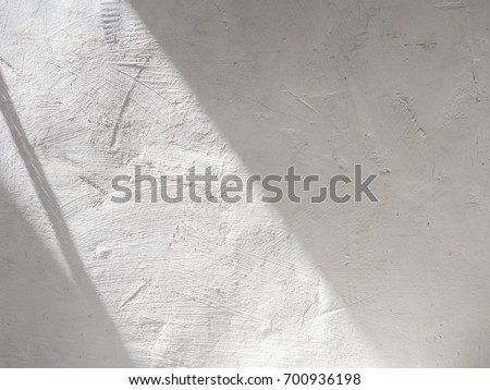 The sun is casting over the white concrete wall,sunshade shadow #700936198