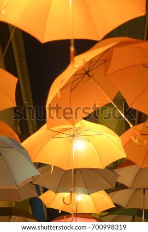 Yellow umbrella hanging #700998319
