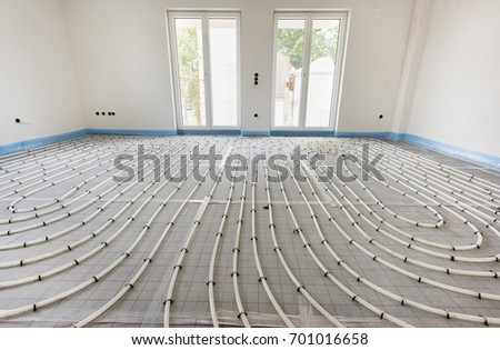 underfloor heating in construction of new residential house Royalty-Free Stock Photo #701016658