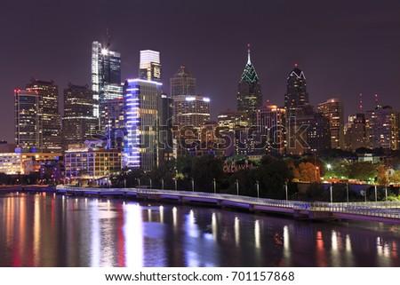 The skyline of Philadelphia illuminated of dusk and Schuylkill River, USA