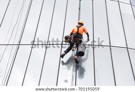 Glass cleaning by spiderman with safety equipment