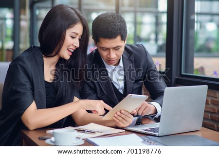 Business woman and business man is working in cafe   , buseness concept #701198776